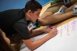 Boy writes on a paper