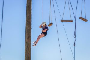 Girl wrapples down in climbing gear