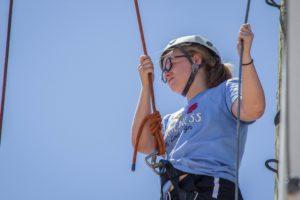 Girl stands in climbing gear