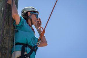 Woman in climbing gear