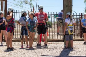 Campers gather together to climb