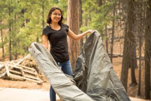 Girl sets up tent