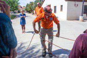 Man pulls rope