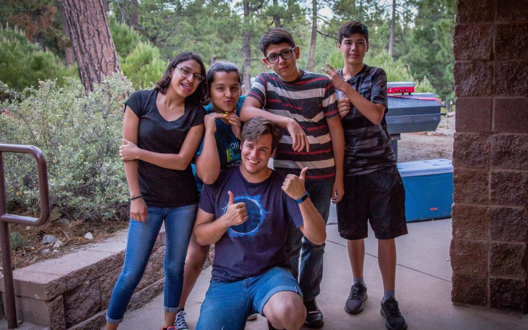 Campers pose for picture on campgrounds