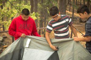 Boys set up a tent