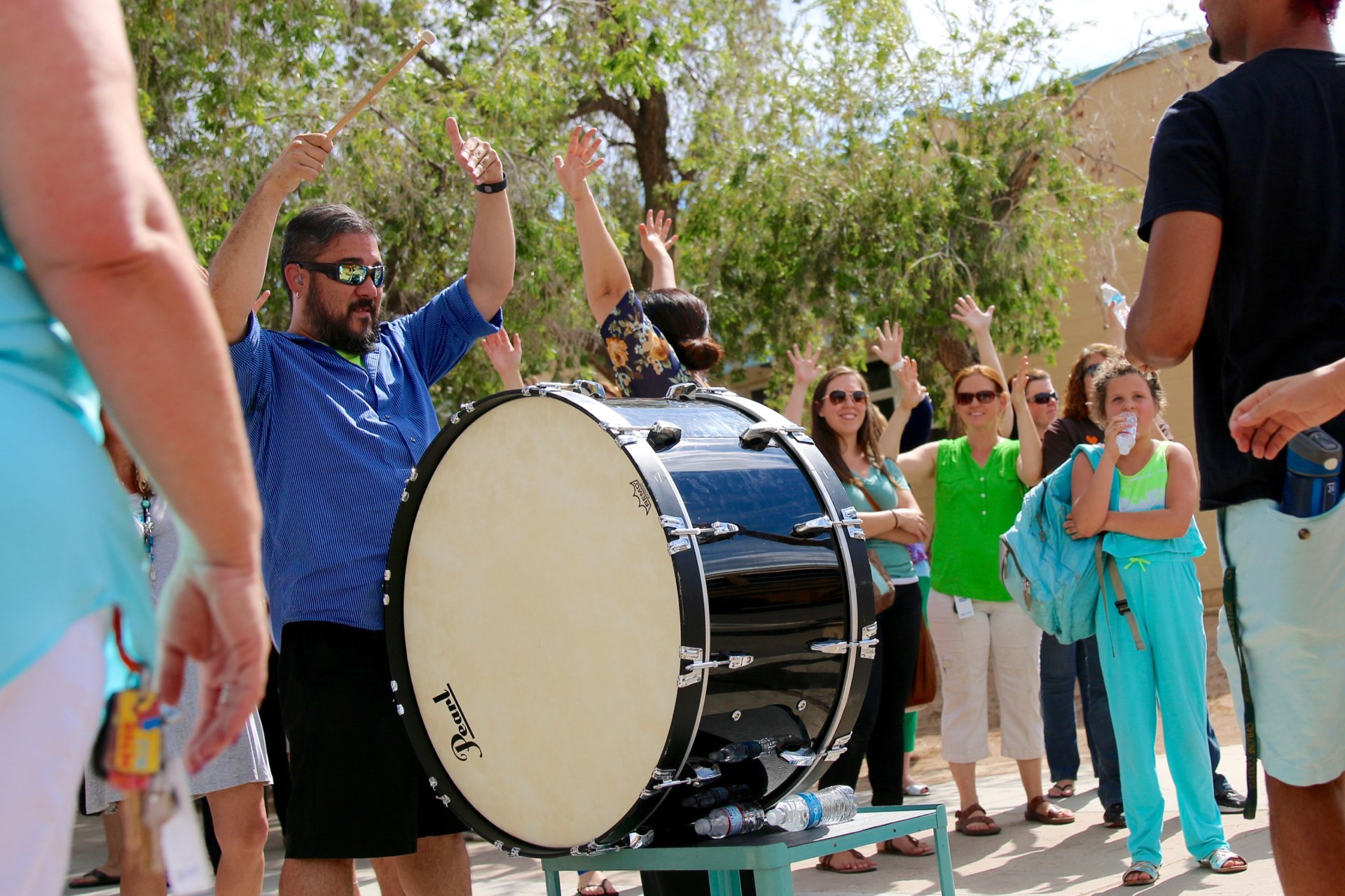Teacher holds drum during the 2016 PDSD bus farewell.