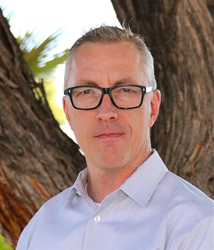 Image of board member Dean Howard smiling at camera.
