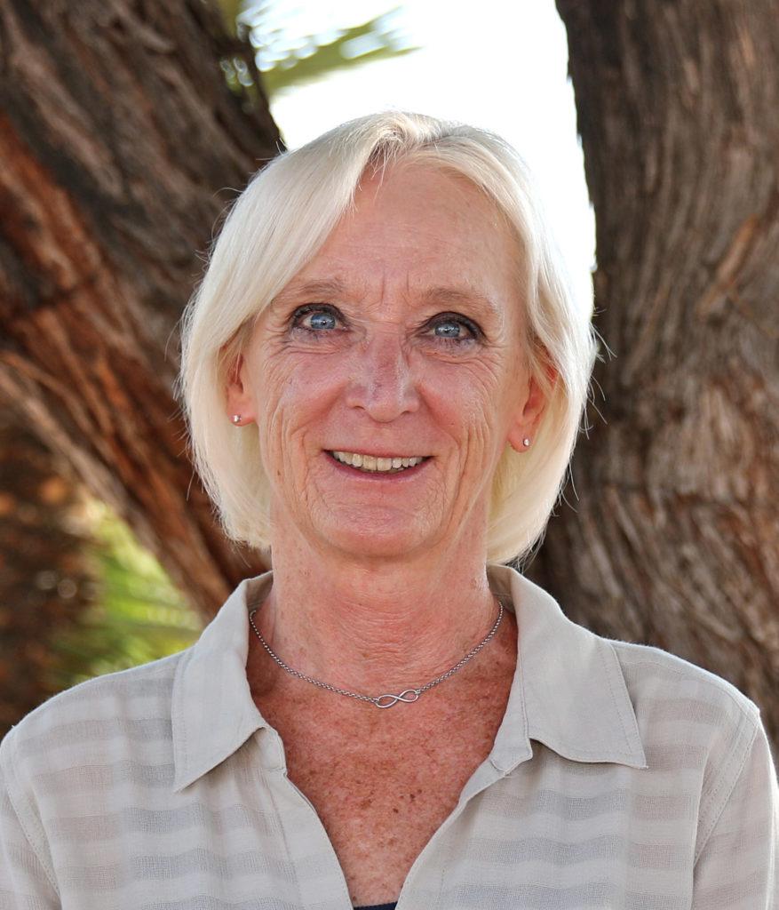 Image of board member Lynne Davison smiling at camera.