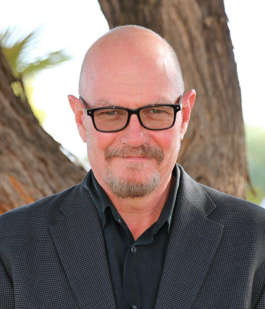 Image of board member Michael Gordon smiling at camera.