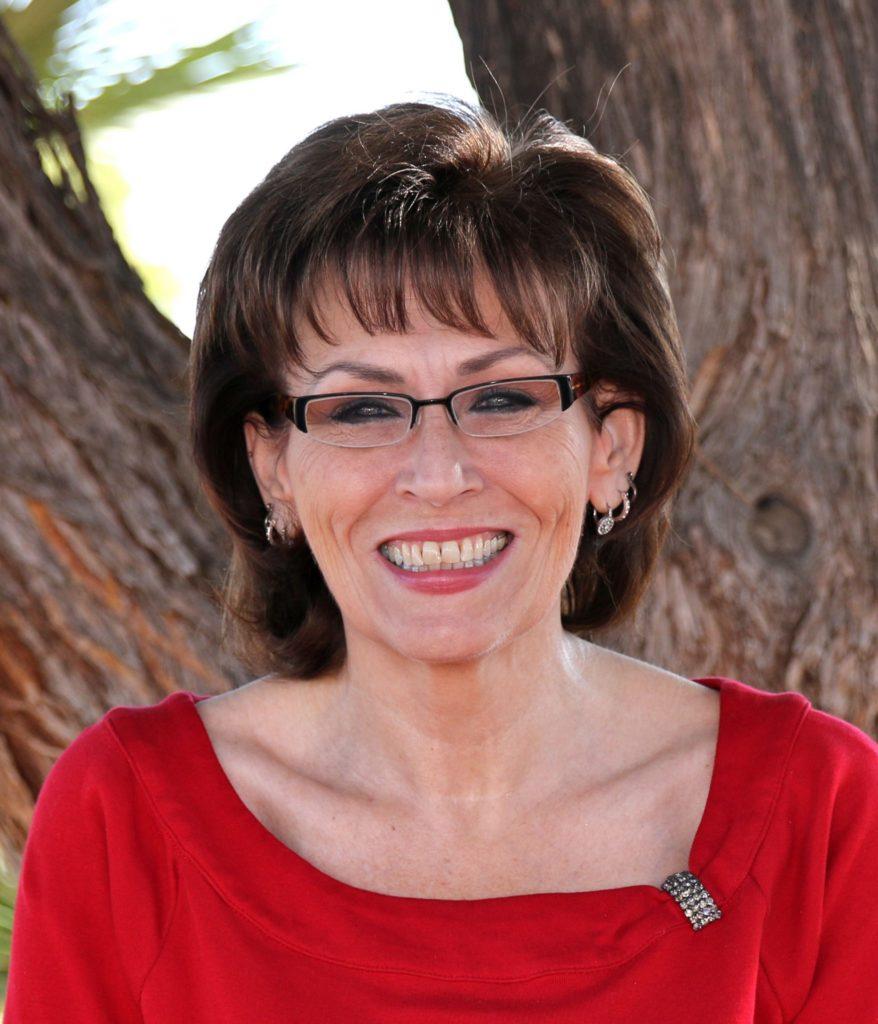 Image of board member Sue Kay smiling at camera.