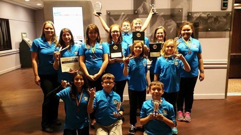 2015 Battle of the Books winners pose while holding their awards.