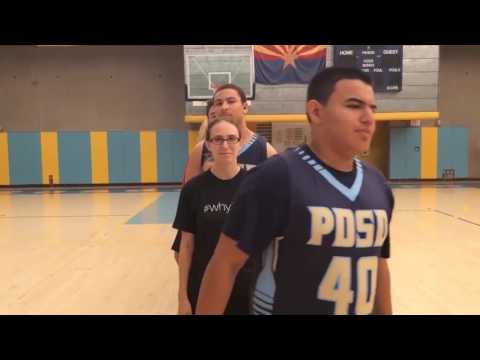 An image still from the PDSD #whyIsign video showing students and staff lined up in the gym.