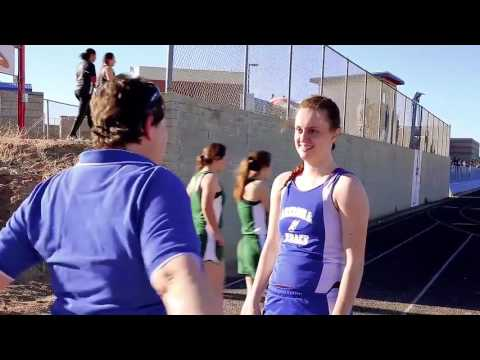 A still image from the ASD track and Field 2017 video showing a student interacting with a staff member.