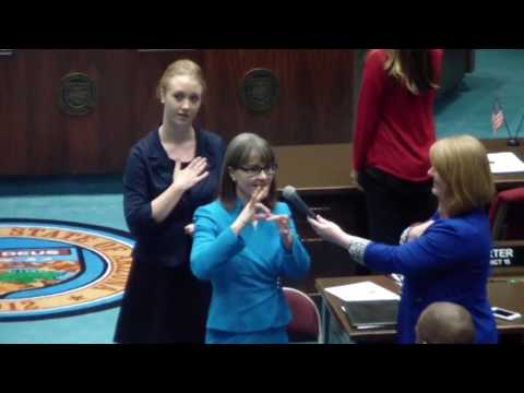 An image still from the Superintendent Reichman opens the Arizona House of Reps floor session with the Pledge of Allegiance video showing Annette Reichman signing the Pledge of Allegiance.