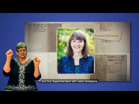 A still photo from the ASDB Museum video that shows Polly Grady-Garcia signing towards the camera.