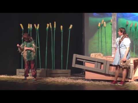 A still photo from the PDSD Wizard of Oz production showing students dressed as the scarecrow and Dorothy.