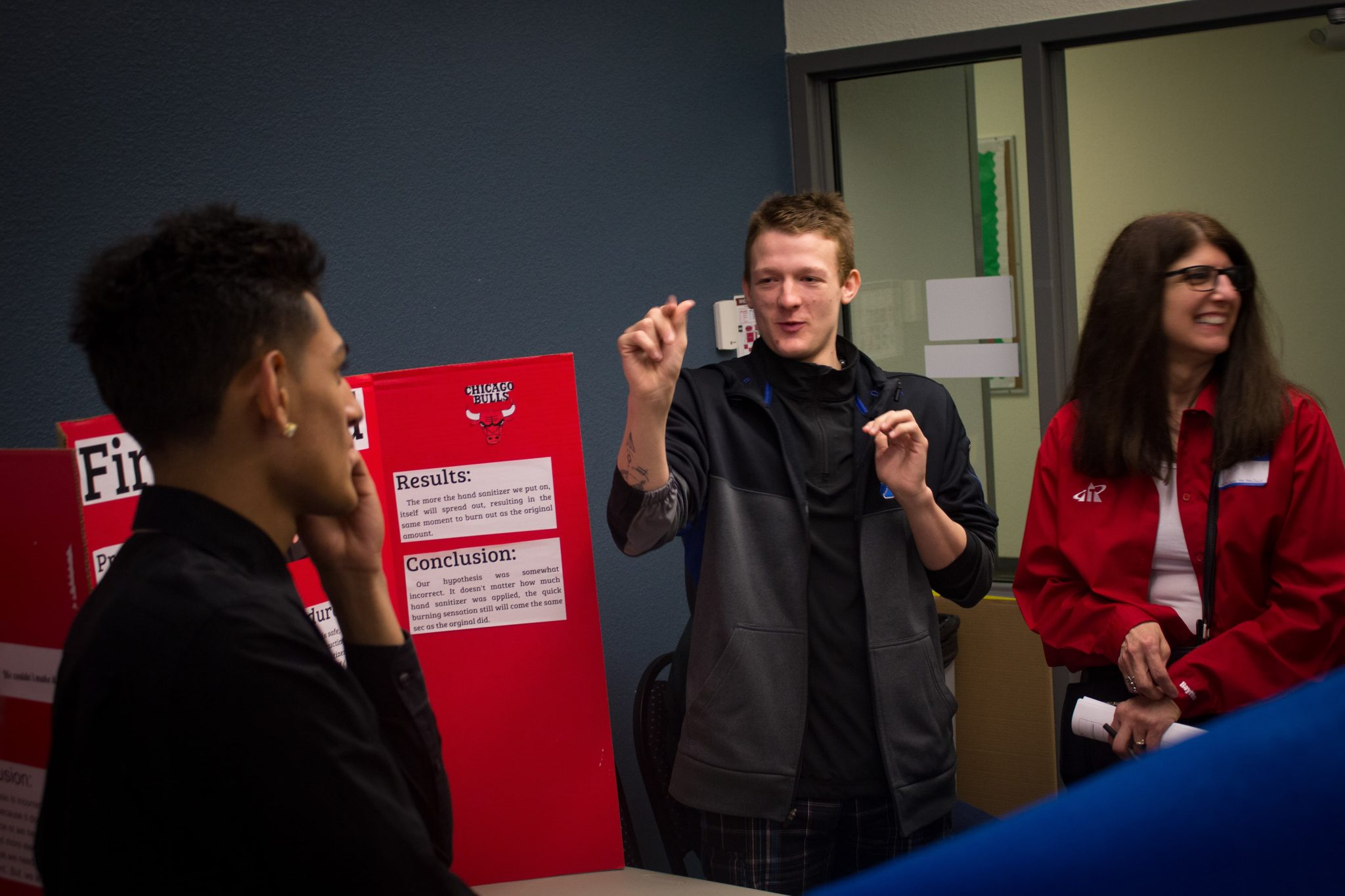 Students and staff interact with science projects at the science fair