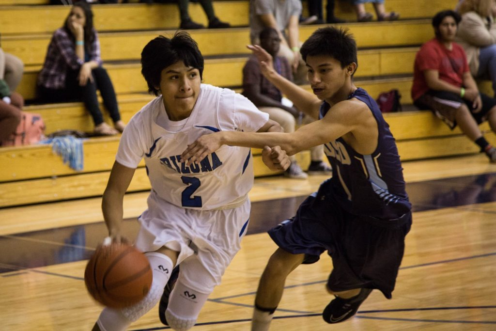 ASD boys basketball player dribbles the basketball