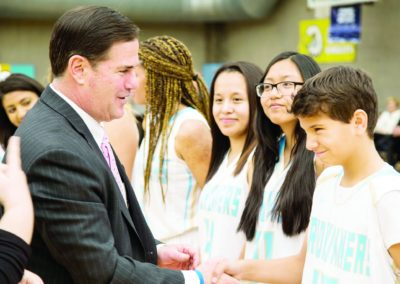 In this January 24, 2018, photo, Gov. Doug Ducey meets with students at the Phoenix Day School for the Deaf. The Arizona State Schools for the Deaf and Blind received additional funds for fiscal-year 2019 to hire more teachers.