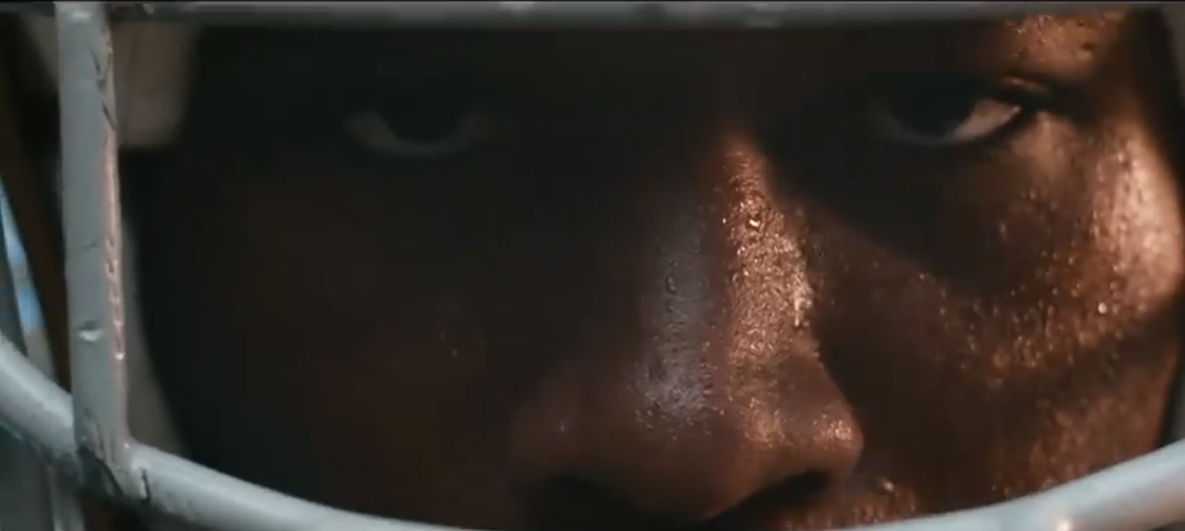 A close up of a Jerrick Coleman's eyes looking straight at the camera. He is wearing a football helmet.