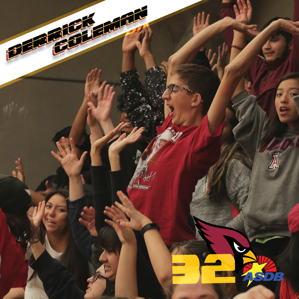 PDSD students cheer and wave their hands in the air