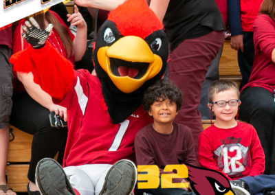 Arizona Cardinals mascot poses with two PDSD students