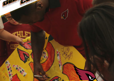 Derrick Coleman signs a poster