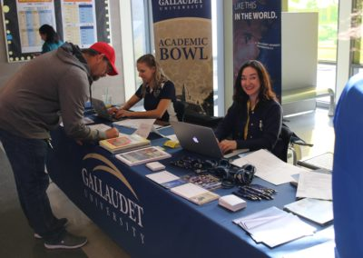 Gallaudet University sit at a booth