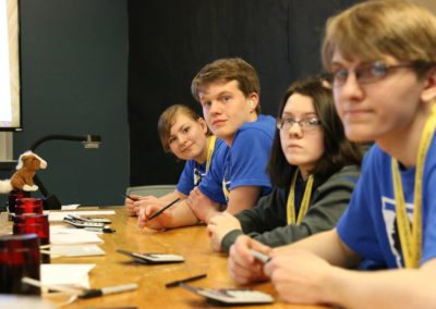 academic bowl participants at a table