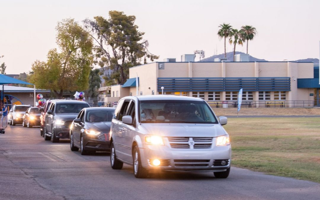 Cars line up for the PDSD 8th grade promotion